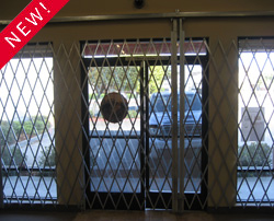 Top track retail store security gate