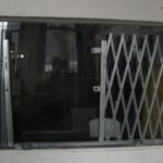 Illinois Engineered Products, IEP, Scissor Gate, Lazy Tong, Bottom Track, Bottom Guide, Folding Security Gates, Safe, Secure, Gate, Folding Gate, Security, Safety, window, storefront