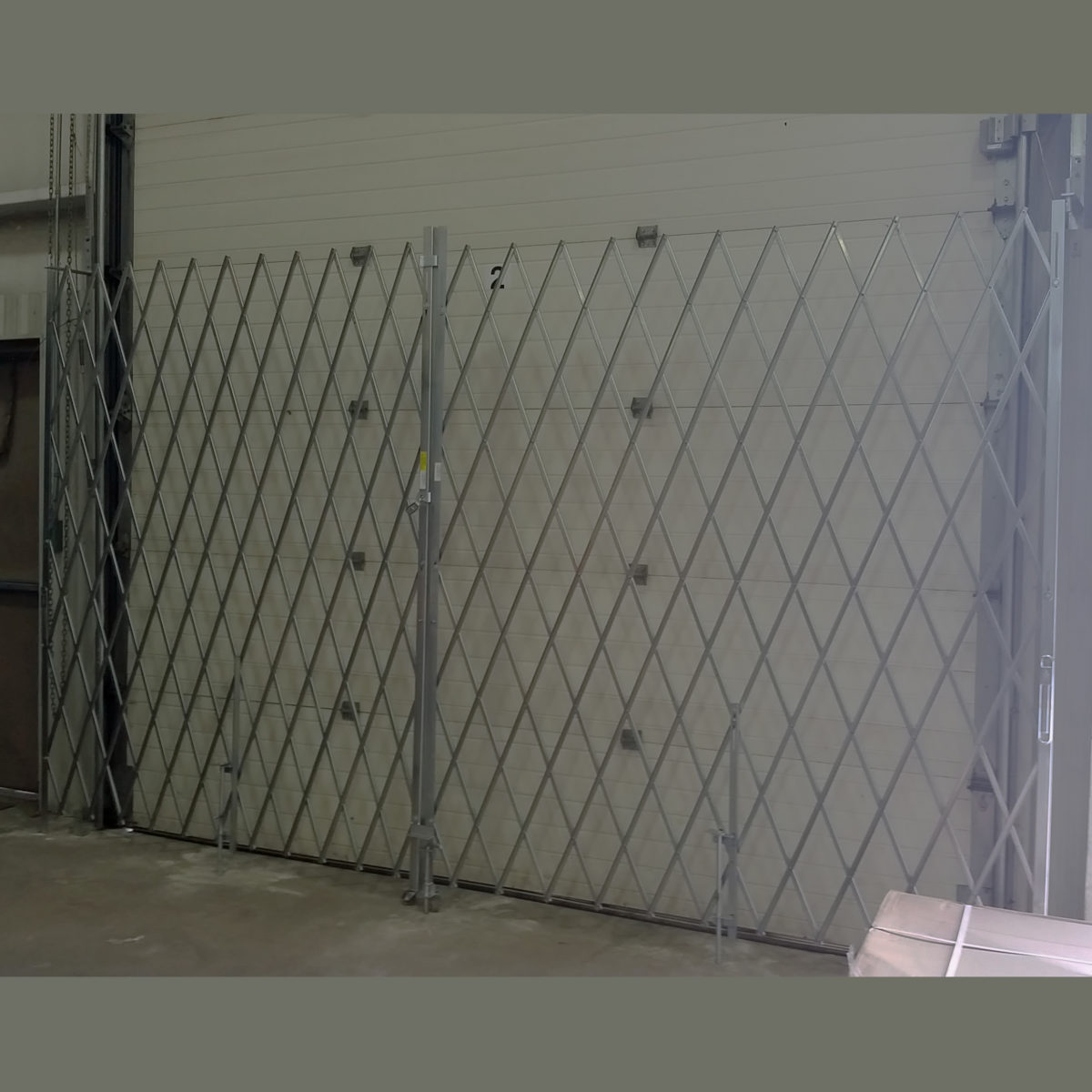 Illinois Engineered Products, IEP, Pair Security Gate, Pair, Folding Security Gates, Safe, Secure, Gate, Folding Gate, Security, Safety, Extra Heavy Duty, Xtra Heavy Duty, Heavy-Duty, Loss Prevention, entry, access, garage, receiving dock, dock door, warehouse, industrial, crash and grab, fencing, fence, Storefront, Store front, Hybrid, Hybrid Gate, Window Gate, Top Track, Bottom Track, Bottom Guide, scissor gate, lazy tong, lazy-tong, Store Security, shop security, face-mount, facemount, roll-down, roll-up, in-jamb, in jam, in door, doorway, install